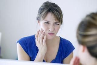 Woman with Jaw Pain | Lake Erie Dental